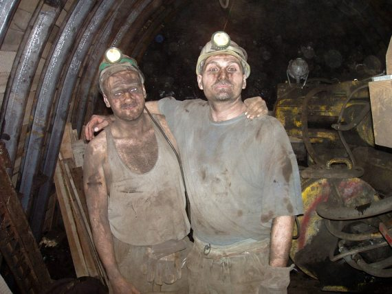 Coal Miner. Two Coal miners are happy to pose for a photo.