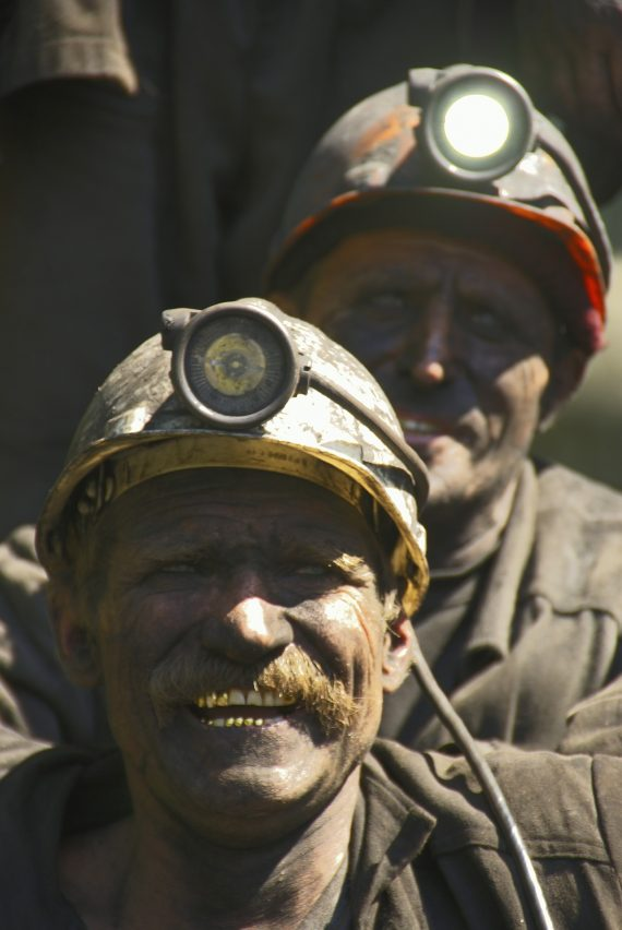 Two dirty coal miners in the Boglands of Ireland